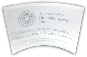 Amidst a plethora of events at the annual State Bar Convention, on Saturday, October 10th, the SCBA' s Diversity Hiring and Retention Committee received the State  Bar of California's Diversity Award.   The award was presented by the Hon. Karen Clopton, Chair of the State Bar's Council on Access and Fairness; Craig Holden, President of the State Bar of California; Judge LaDoris Cornell (ret.);  and Chief Justice Tani  Cantil-Sakauye. The State Bar Diversity Awards were established to recognize outstanding efforts and significant contributions ensuring the full and equal opportunity of all persons for entry and advancement in California's legal profession.  These efforts help to increase public trust and confidence in the integrity of the profession and the legal system as well  as create the perception of fairness  in the courts.  SCBA's Diversity Retention and Hiring Committee celebrated its 25th  Anniversary this year. Accepting the award were Executive Director Mary Burroughs, First Vice-President Heather Hoganson, and Committee Chair Linda Partman.