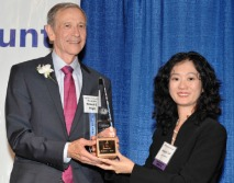 Judge Robert Hight receiving the SCBA Judge of the Year Award from Angela Lai - SCBA President